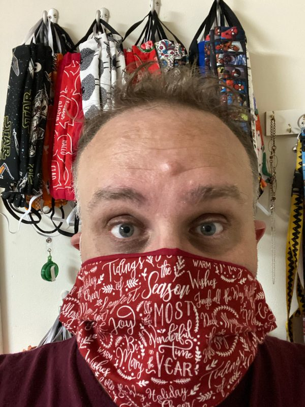 Red Christmas Sayings Face Mask - This Christmas Face mask has a lot of different types of Christmas sayings. #Christmas