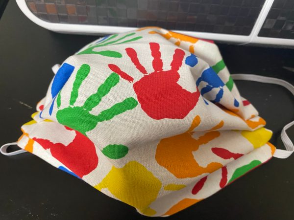 Colorful Handprint Face Mask this face mask has handprints on it in various colors. #Handprint