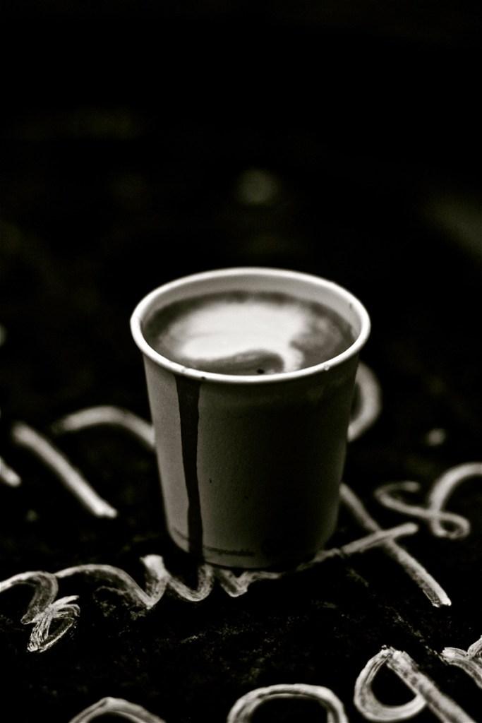 Monmouth Coffee single farm Espresso Machiatto photographed on chalk board