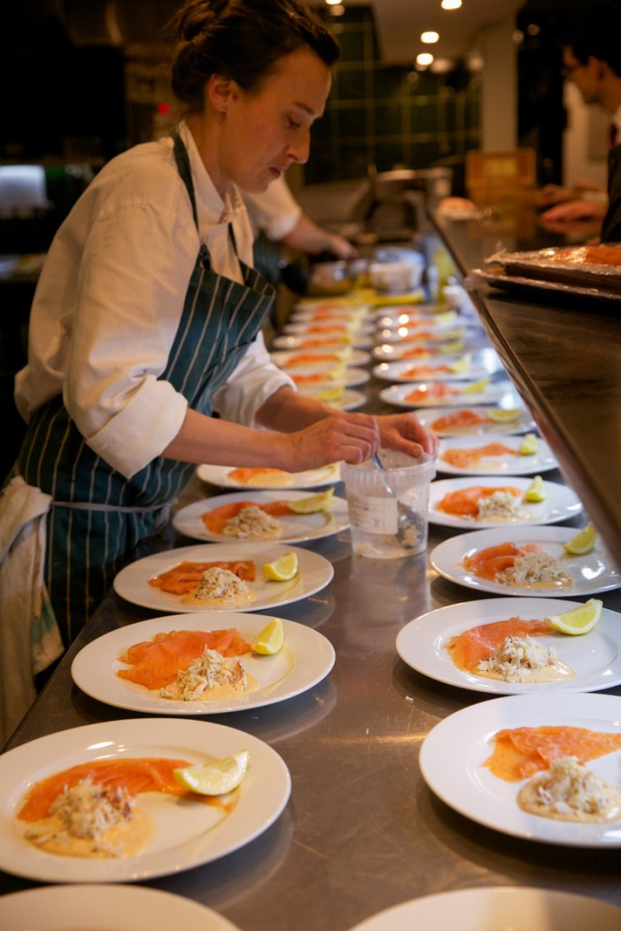 Kitchen shot of staff at Sally Clarkes Restaurant, preparing cured salmon and fresh Cornish crab