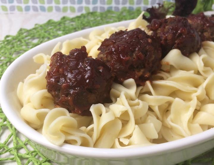 bbq meatballs served over egg noodles
