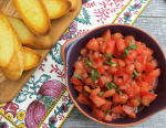 bowl of classic tomato bruschetta with toast points