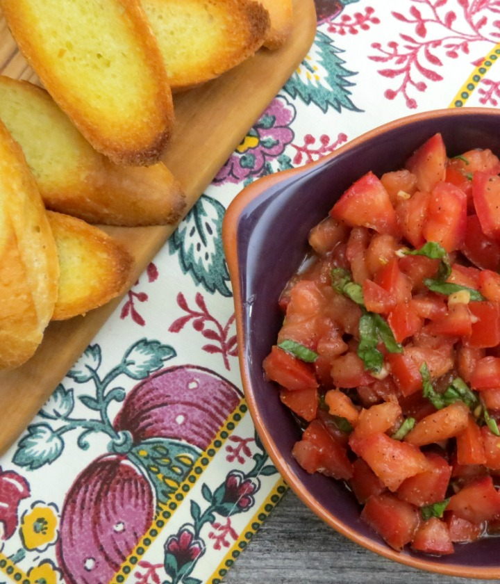 bowl of bruschetta with toast points