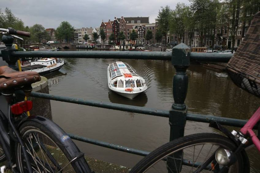 Ghost bike cycling holiday in Amsterdam Holland canal