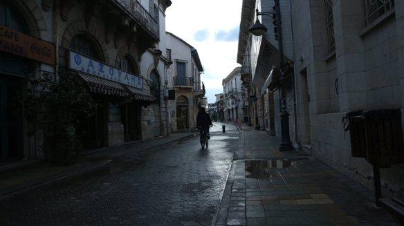 Stewart Innes 20190100 Cyprus Limassol old town street bike in rain fb