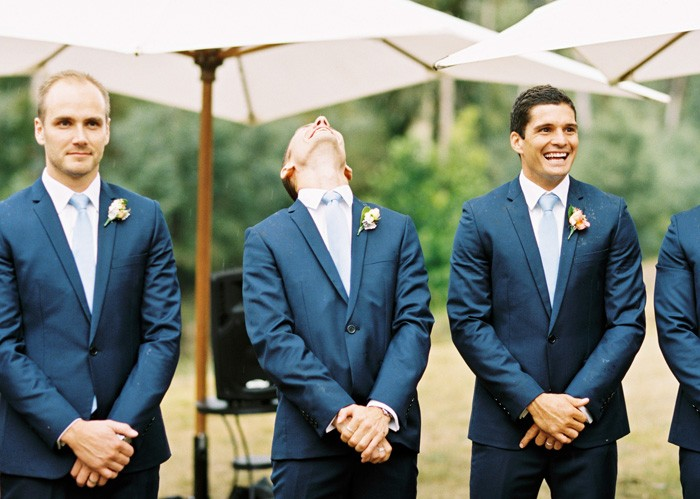grooms reaction to his bride when he sees her as she walks down the wedding aisle