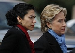 US Democratic presidential candidate Senator Hillary Clinton (D-NY) (R) walks with her traveling chief-of-staff Huma Abedin as they approach a group of police officers after cancelling a rally in Fort Worth, Texas February 22, 2008. A Dallas police officer was killed Friday when his motorcycle struck a pillar as he was escorting democratic presidential candidate Senator Clinton to a rally in Dallas. Clinton cancelled the rally in Forth Worth, saying it would be inappropriate to hold a rally in light of the tragic circumstances. REUTERS/Jessica Rinaldi (UNITED STATES) US PRESIDENTIAL ELECTION CAMPAIGN 2008 (USA)