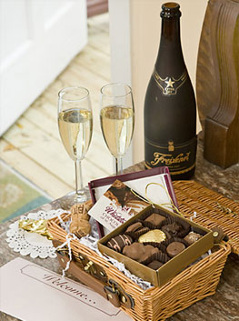 a basket of sweet treats with champagne