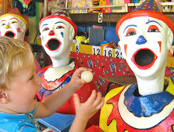 Child with clown game at kids amusements