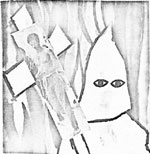 person dressed as KKK member, holding a cross with a photo of Hekima Ana on it