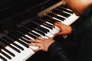 Hand xon piano keyboard, playing