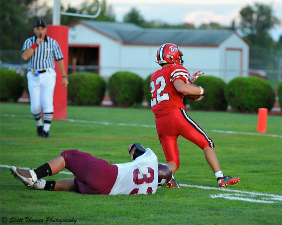 Baldwinsville Bees runningback Ben Paprocki (22) scores one of his four touchdowns against the Central Square Redhawks.