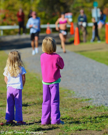 Two young girls wait for the first women to finish the Apple Run 15K Road Race at the LaFayette Apple Festival.