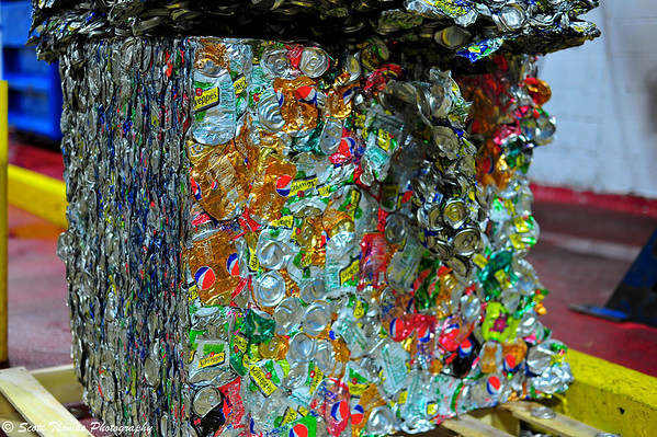 A brick of metal soda cans ready to be recycled.