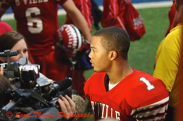 Malik Burks (1) is interviewed by local television after being named Most Valuable Player for Baldwinsville.  Baldwinsville defeated CBA to claim the New York State Section III High School Football Championship.