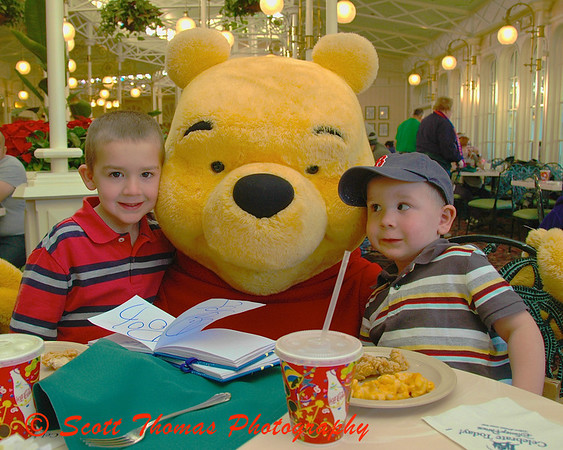 My niece's sons meet Winnie the Pooh in the Magic Kingdom's Crystal Palace character meal at Walt Disney World.