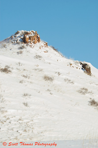 Most of the Badlands rock formations where snow covered but I found an example of a scoria cap on this butte in the Theodore Roosevelt National Park.