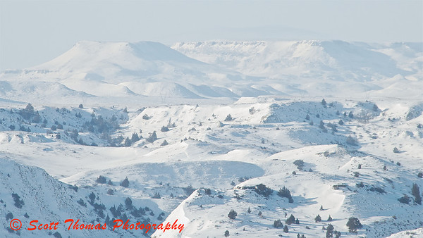 A white landscape in the Theodore Roosevelt National Park near Medora, North Dakota.  By shooting at an angle away from the sun, the sky washed out and blended into the Badlands.