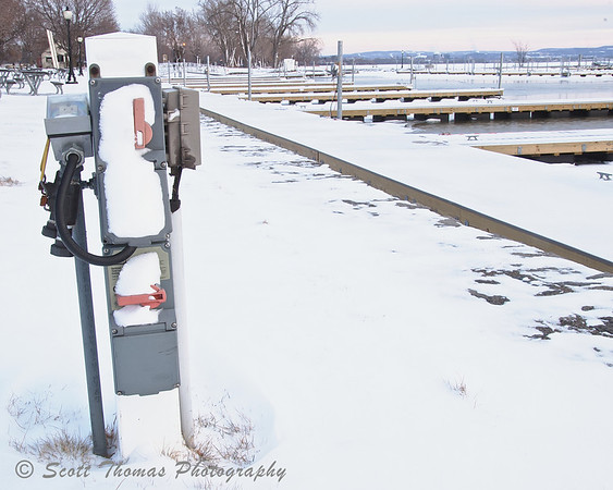 Hibernation. Utility hookup for boats hibernate in the Onondaga Lake Park Marina in January.