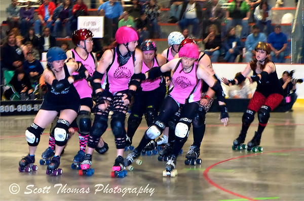 This is a jammer coming up on the gaggle of blockers she has to get past in order to score points for her team.