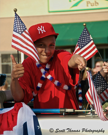 An All-American Boy giving me the thumbs up during the Baldwinsville, New York, Memorial Day parade on Sunday, May 30, 2010.  Taken with the Nikon D70 and, you guessed it, the Nikon 18-200VR lens at 1/320s, f/6.3, ISO 200, EV +0.3, 105mm focal length.