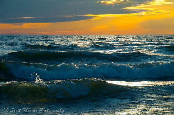 Dramatic lighting on Lake Ontario waves before sunset.
