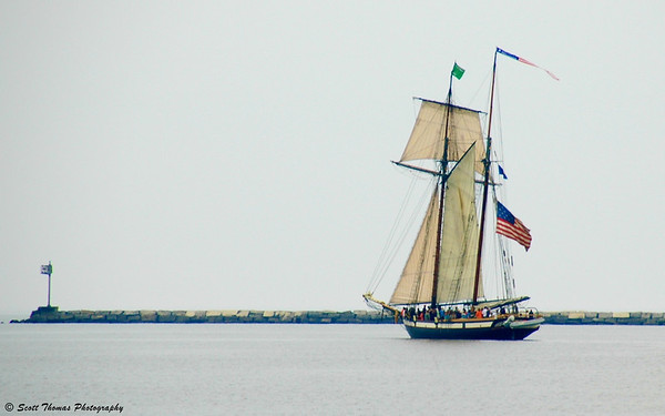 The Privateer Lynx, a replica of an 1812 warship, sails out of Oswego Harbor during the Festival of Sail in Oswego, New York on Saturday, June 16, 2010.
