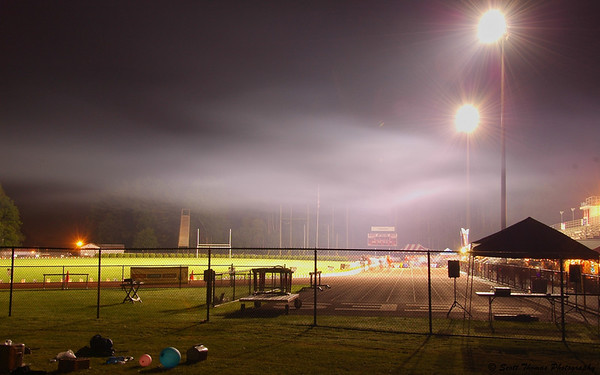 People walking during the Baldwinsville Relay for Life at 2:25AM as a cold fog hangs overhead.