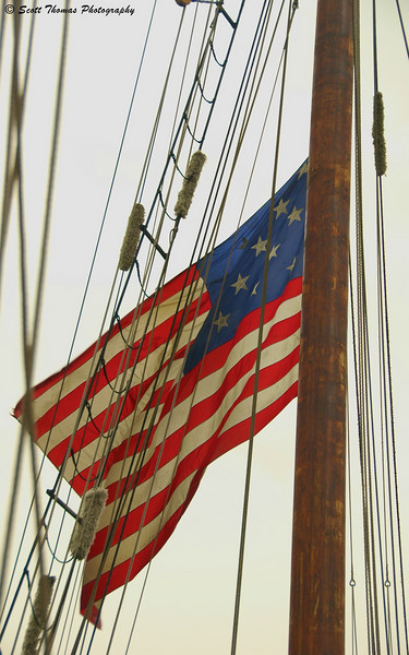 The 15 star-15 stripe U.S. Flag flown by the tall ship Privateer Lynx during a daysail at the Festival of Sail in Oswego, New York.