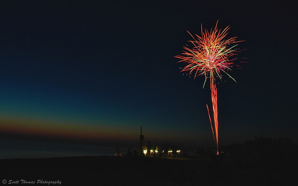Fireworks being let off on a Lake Ontario beach in celebration of the 4th of July holiday in the United States.
