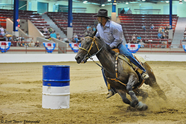 Rounding a barrel during the New York State Fair Barrel Racing Championship on Saturday, August 2, 2010.