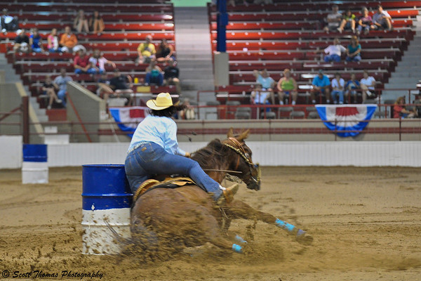 A horse and rider go down during the barrel racing event at the New York State Fair on Saturday, August 28, 2010.
