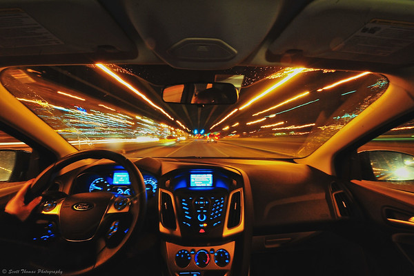 View out the front windshield of a 2012 Ford Focus driving around Syracuse, New York.