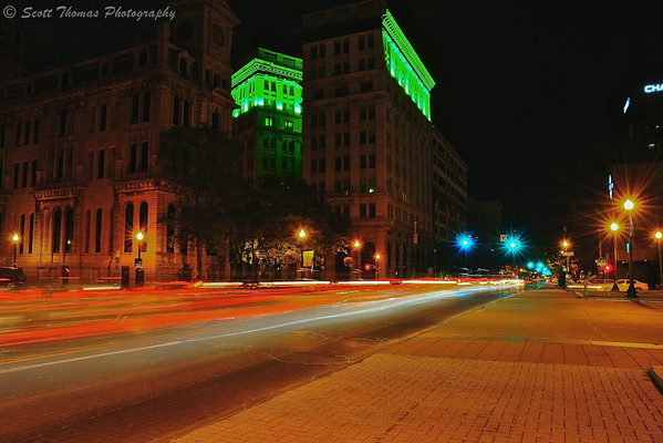 Cars going up and down Salina Street and leaving light trails over a long exposure as they passed the Onondaga Savings Bank building and Clinton Square taken during the Syracuse Area Photography Classes Teaching Tour: Syracuse at Night on Saturday, July 12, 2014.
