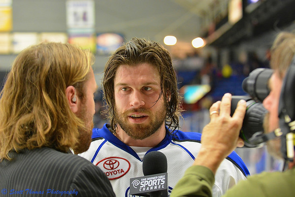 Syracuse Crunch J. T. Wyman (15) being interviewed by Eric Neilson on Time Warner Cable Sports after defeating the Springfield Falcons in American Hockey League (AHL) Calder Cup Playoff series at the Onondaga County War Memorial on Friday, May 17, 2013.