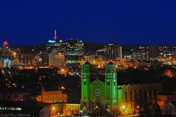 Most Holy Rosary Church with the City of Syracuse, New York skyline behind it.