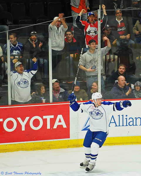 Syracuse Crunch fans and Matt Taormina (6) celebrate his goal.