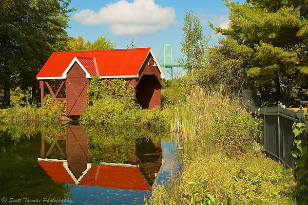 Red covered bridge behind the 1000 Islands Visitor Center just off of Interstate 81 in between Clayton and Alexandria Bay, New York.