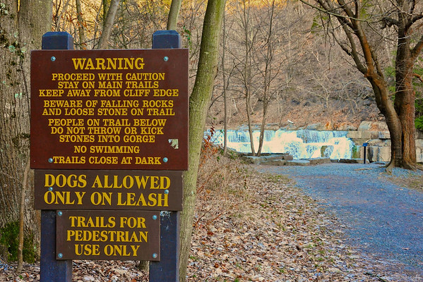 Warning sign at the start of the Gorge Trail in Taughannock Falls State Park near Ithaca, New York.