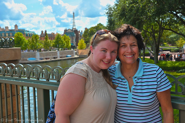 People posing with Epcot's France pavilion in the background, Walt Disney World, Orlando, Florida.