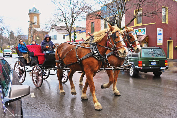 Horse drawn carriage on the streets of Skaneateles, New York during a Dickens Christmas.