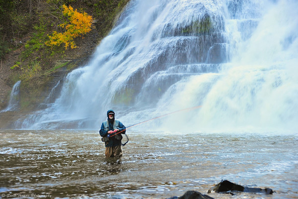 A fisherman near Ithaca Falls in Ithaca, New York.