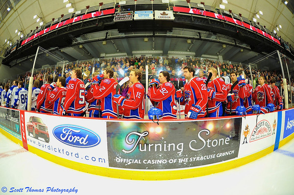Hamilton Bulldogs bench during the National Anthems before playing the Syracuse Crunch in an American Hockey League (AHL) game at the Onondaga County War Memorial on Saturday, November 23, 2013.