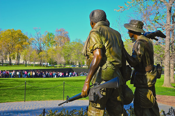 The Three Soldiers bronze statue overlooking the Wall at the Vietnam Veterans Memorial on the National Mall in Washington, DC.
