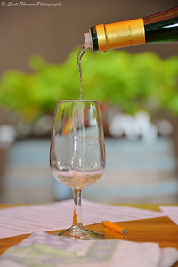 Wine being poured for a tasting at the Hermann J. Wiemer Vineyard in the Finger Lakes region of New York.
