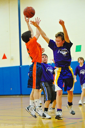 Taking a shot during an Intramural boys basketball game.