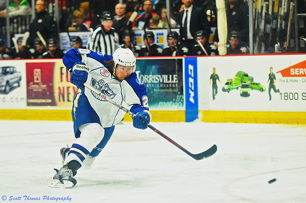 Syracuse Crunch Pierre-Cedric Labrie (20) one times a shot into the net for his sixth goal of the season against the Wilkes-Barre/Scranton Penguins.