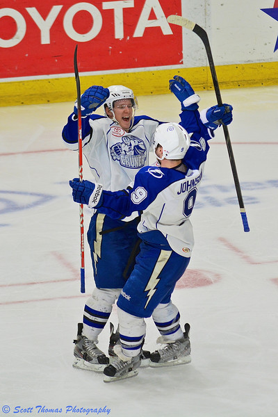 Syracuse Crunch Ondrej Palat (12) celebrates Tyler Johnson's (9) goal against the Springfield Falcons in American Hockey League (AHL) Calder Cup Playoff action at the Onondaga County War Memorial on Wednesday, May 15, 2013.