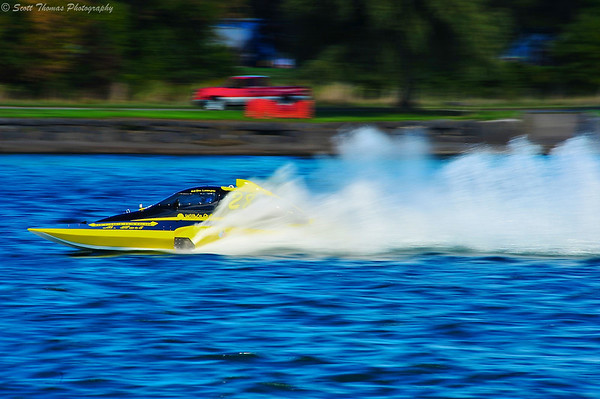 2.5 Liter Inboard Hydroplane flies down the front stretch at the 2012 HydroBowl in Geneva, New York.