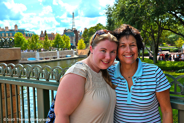 My daughter and her French teacher with Epcot's France pavilion in the background at Walt Disney World, Orlando, Florida.